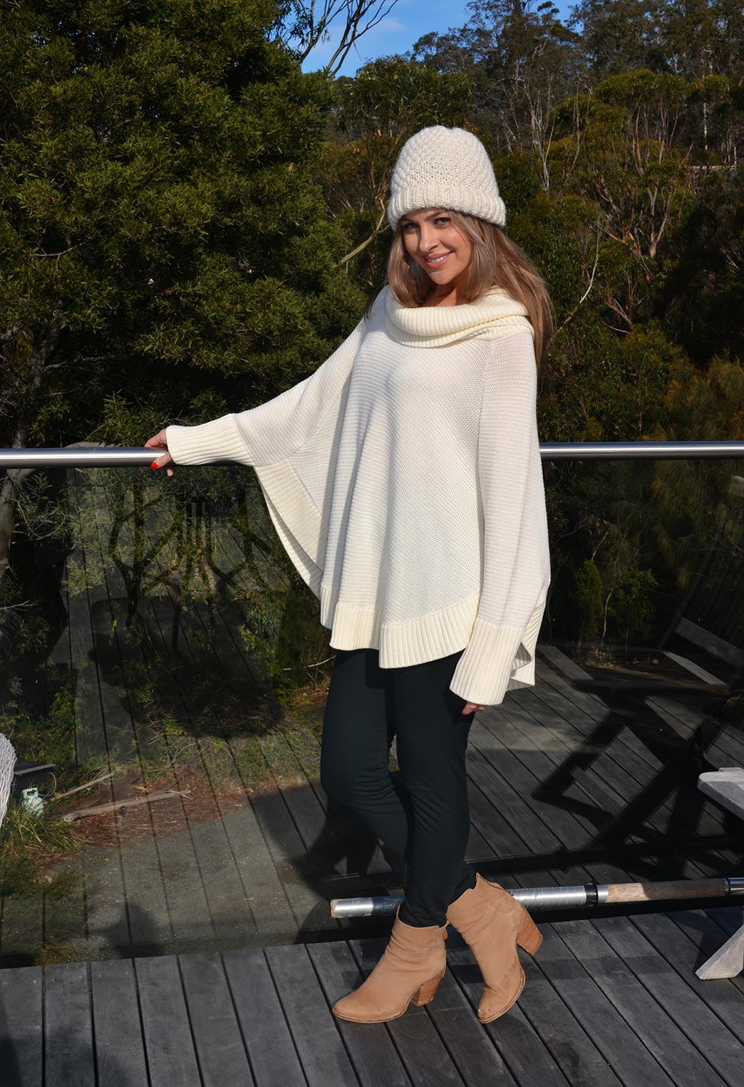 Ivory Poncho with Cowl Black Fleece Leggings