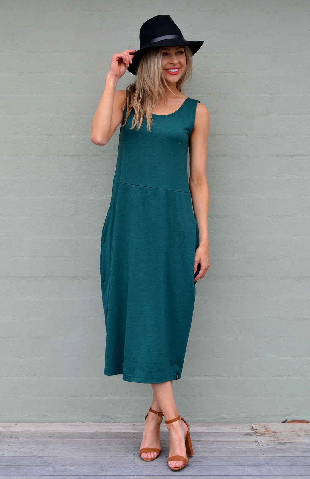 Rosie Dress - Women's Merino Wool Emerald Green Sleeveless Dress with Curvy Skirt and Pockets - Smitten Merino Tasmania Australia