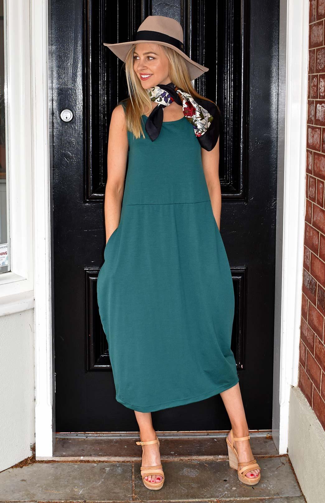Rosie Dress - Women's Merino Wool Emerald Green Sleeveless Dress with Curvy Skirt and Pockets - Smitten Merino Tasmania Australia