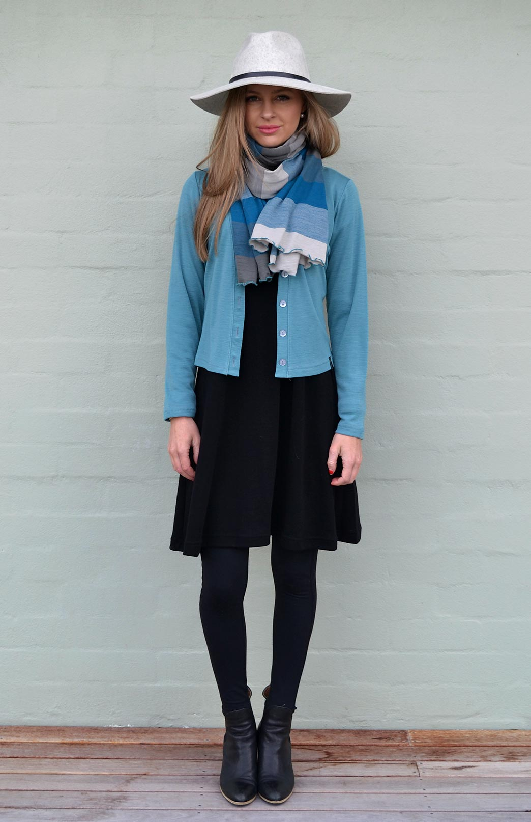 Our model wearing the Smitten Scarf in Teal Multi