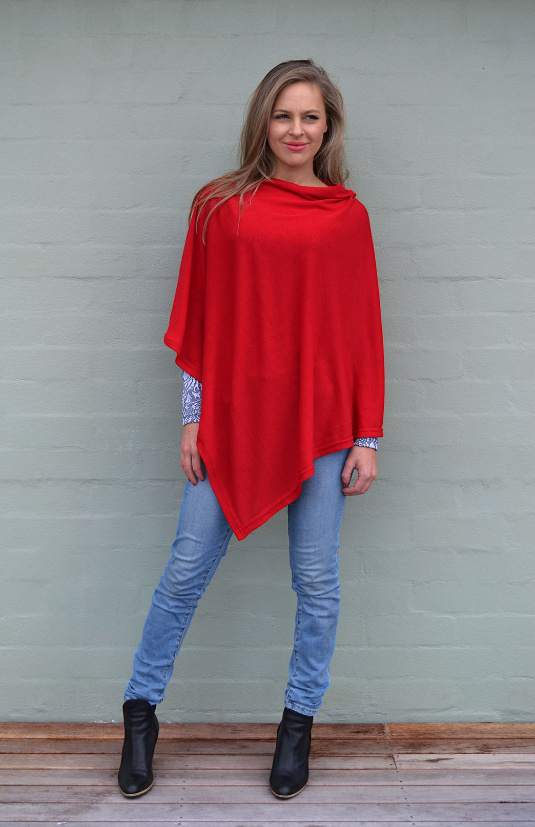 Our model wearing Classic Poncho in Flame Red