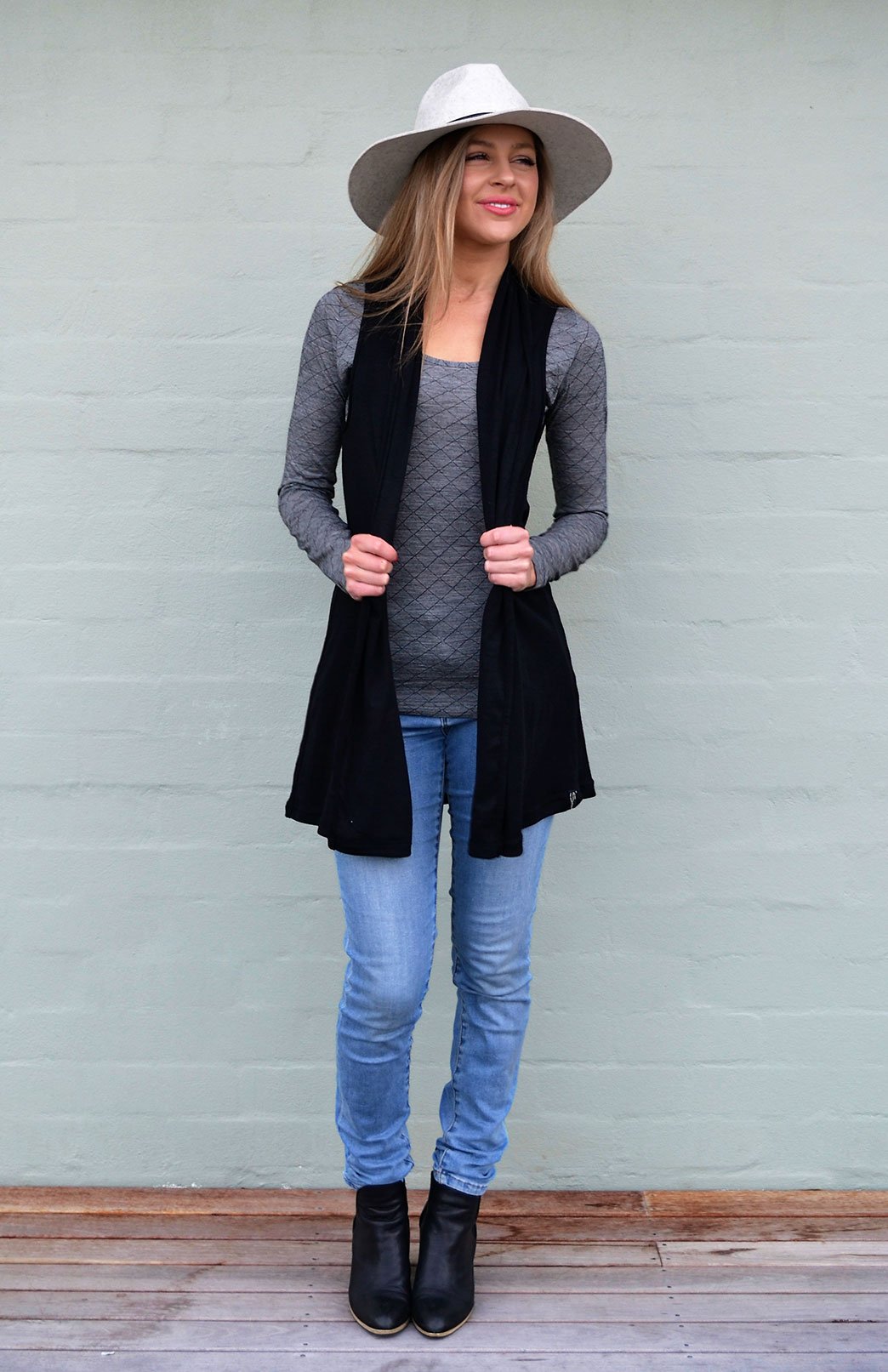 Sleeveless Drape Cardigan - Women's Black Merino Wool Sleeveless Drape Cardigan with no buttons or fastenings - Smitten Merino Tasmania Australia