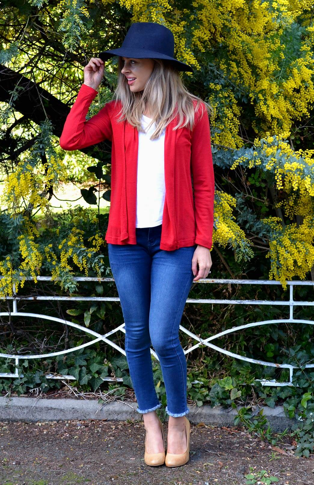 Our Model wearing Mini Drape Cardigan in Flame Red