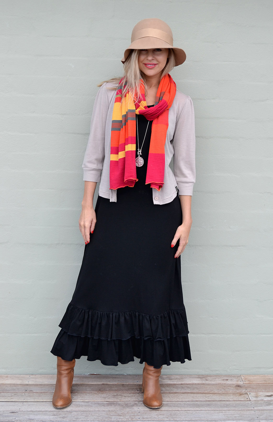 Our model wearing the Smitten Scarf in Orange Multi