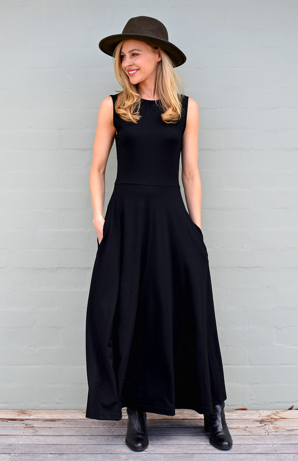 Flo Dress - Women's black sleeveless merino wool dress with high neckline, side pockets, long skirt and dropped waist - Smitten Merino Tasmania Australia