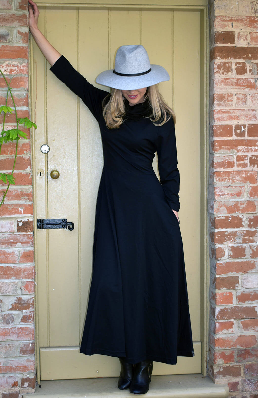 Florence Dress - Women's black long sleeved merino wool dress with high neckline, side pockets, long skirt and dropped waist - Smitten Merino Tasmania Australia