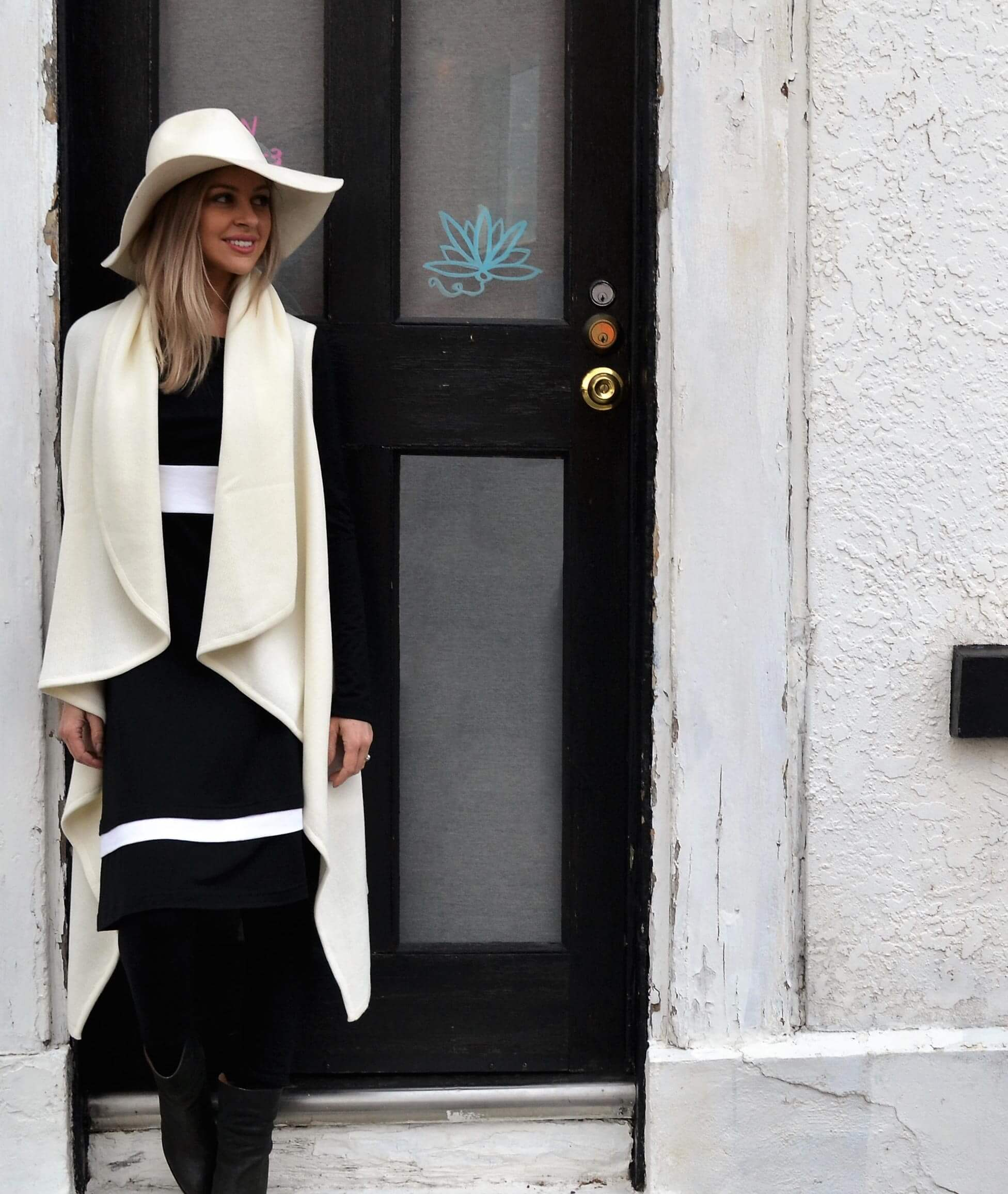 Our model wearing Black and Ivory Indi Dress, Ivory Sleeveless Wrap and Black Wool fleece Leggings
